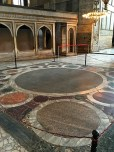 Called the Omphalion, the green marble circle in the middle marks the spot where the Emperor would sit during church services. The coronation of every Byzantine Emperor was held on this big dot.