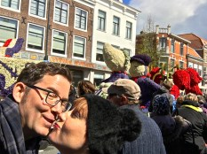 """Matthew takes a peek while trying perfect our """"Kissing Delft Dutch Couple"""" pose (note the float in the background.)"""