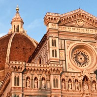 """The current façade of the church was designed and completed in 1876 by Emilio De Fabris, who sought to create a Gothic theme that would harmonize nicely with Giotto's bell tower and the Baptistery. Okay, I can't resist. One last story about the dome: In 1419, the city's wool-merchant guild held a competition to design it. Two goldsmiths entered; Lorenzo Ghiberti and Filippo Brunelleschi. Back in 1401, Ghiberti had won the commission to design the Baptistery doors, but Brunelleschi managed to clinch the dome competition. The two continued to be fierce rivals, with Ghiberti bragging he could do a better job during contruction. At one point, Brunelleschi """"called in sick,"""" allowing Ghiberti to take over the project. Eventually, Ghiberti threw in the towel, and Brunelleschi swaggered back in to save the day."""