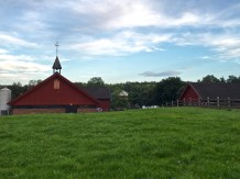 """If you continue along the path to Bygdøy Peninsula, you'll come to the Bygdø Royal Manor, commonly called """"The King's Farm."""" The land has been in continuous use by royals since 1305, when King Haakon V Magnusson gave Bygdøy as a gift to his queen, Eufemia. Today, while the site is officially owned by the government, the farm is run by the Norwegian Folk Museum, which is about a block down the road."""