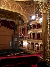 From the Emperor's box, you can see the innovative metal stage curtain. With a 90-minute fire rating, it was designed to prevent flames from spreading towards the audience. Its efficacy has been successfully tested three times, when onstage special effects have run amok, and when fire has broken out backstage.