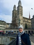 Matthew stands in front of Grossmünster's twin steeples, which have become the city symbol. The Neo-Gothic domes are replacements for the originals, which were damaged in a fire in 1781.