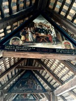 "Painted from 1616 to 1637, only 45 of the bridge's original 67 panels remain intact. They're the largest known depiction of a Totentanz cycle, or Danse Macabre in French (both mean the ""Dance of Death."") Each panel shows townsfolk living life and making merry while Death parties unseen alongside them. It was intended as a reminder to make peace with your creator, since death awaits us all -- an apt message in an era filled with plagues and war. Each of the panels had a sponsor, whose family crest appears on the left. The crest of his wife's family appears on the right, and a verse describing the painting's theme and naming the donors runs beneath the image."