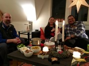 """The group dunks dippables in some Swiss fondue and watches """"Dinner for One"""" before the main meal."""