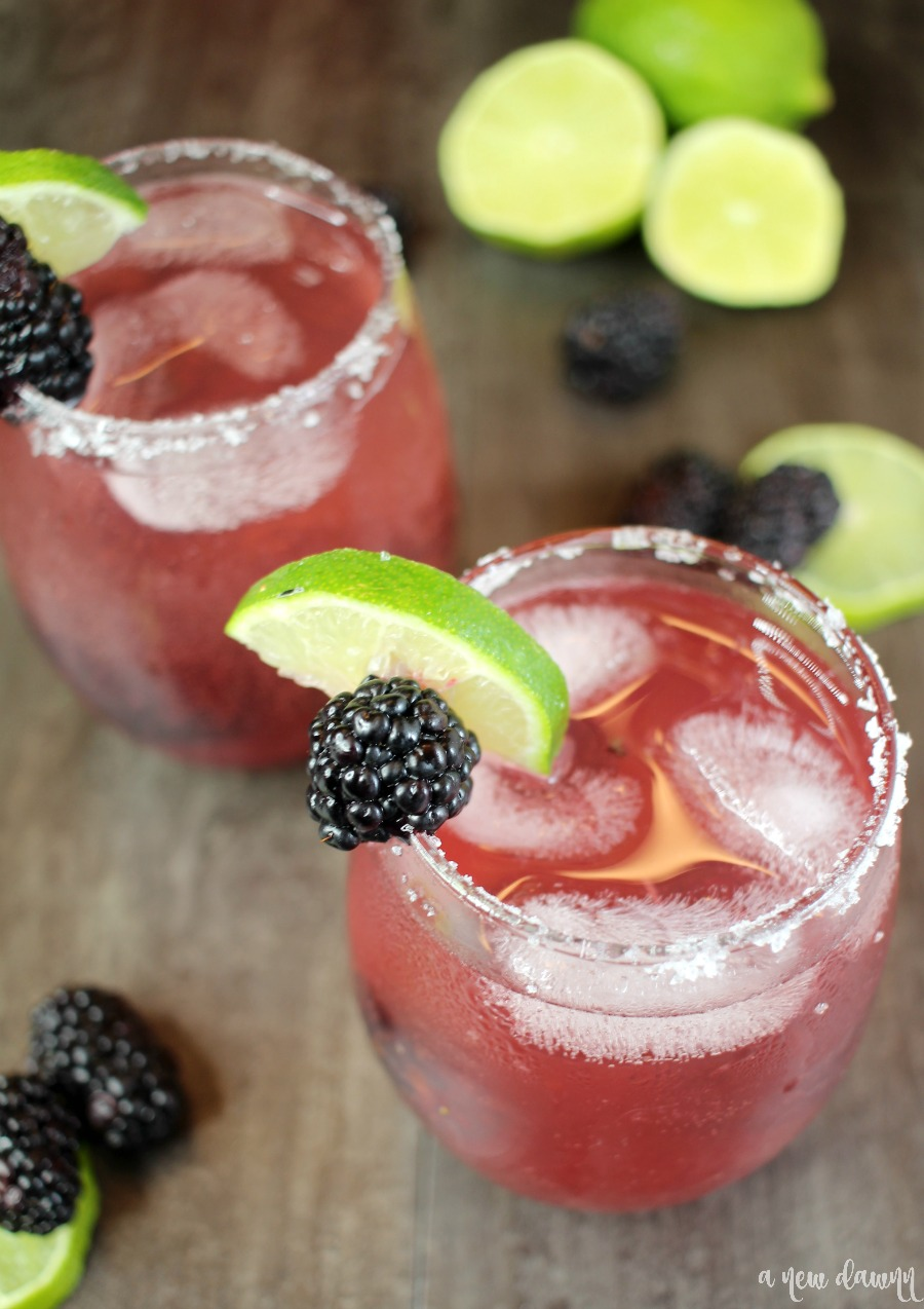 Blackberry and lime wedge on glass of Sparkling Blackberry Lime Margarita