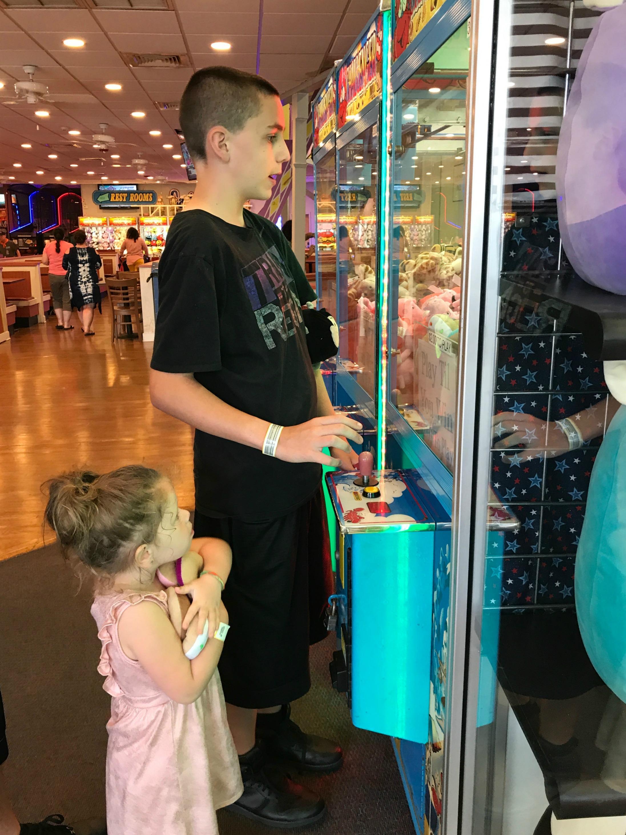 kids playing arcade game at casino pier