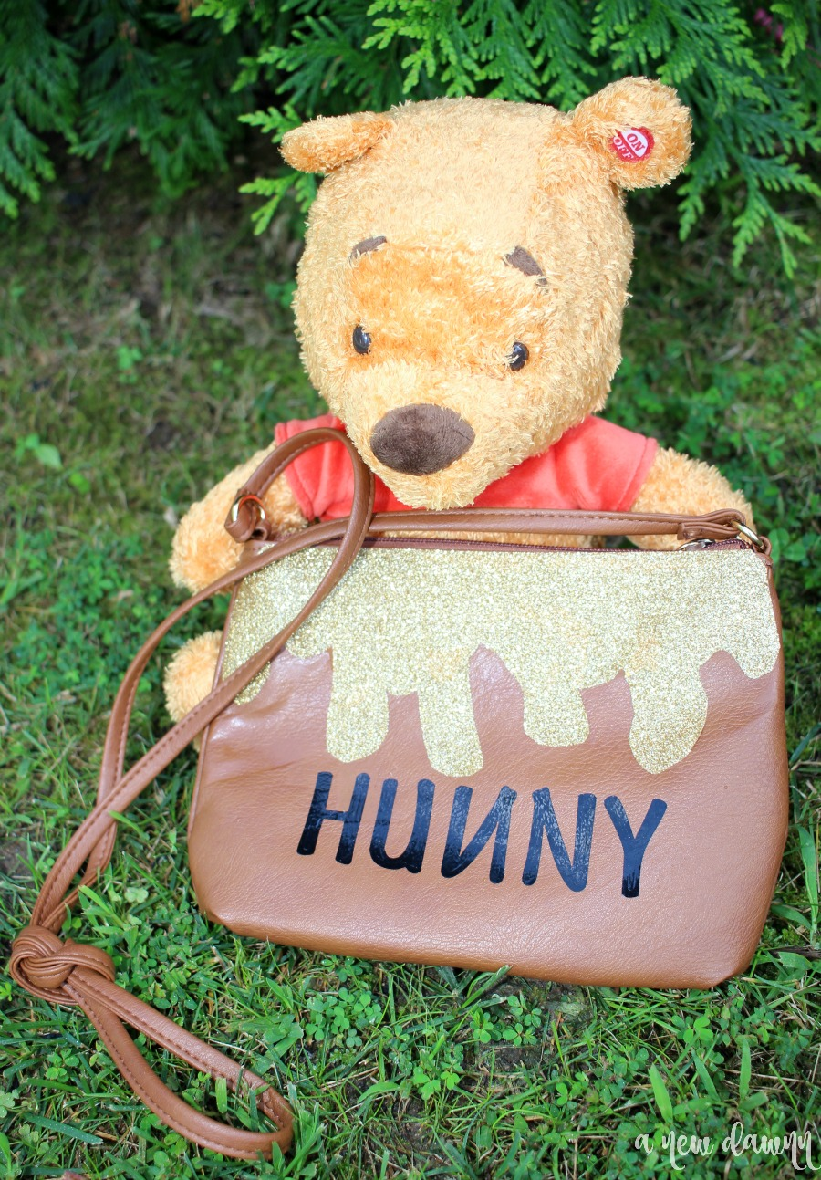 pooh bear holding huny pot purse