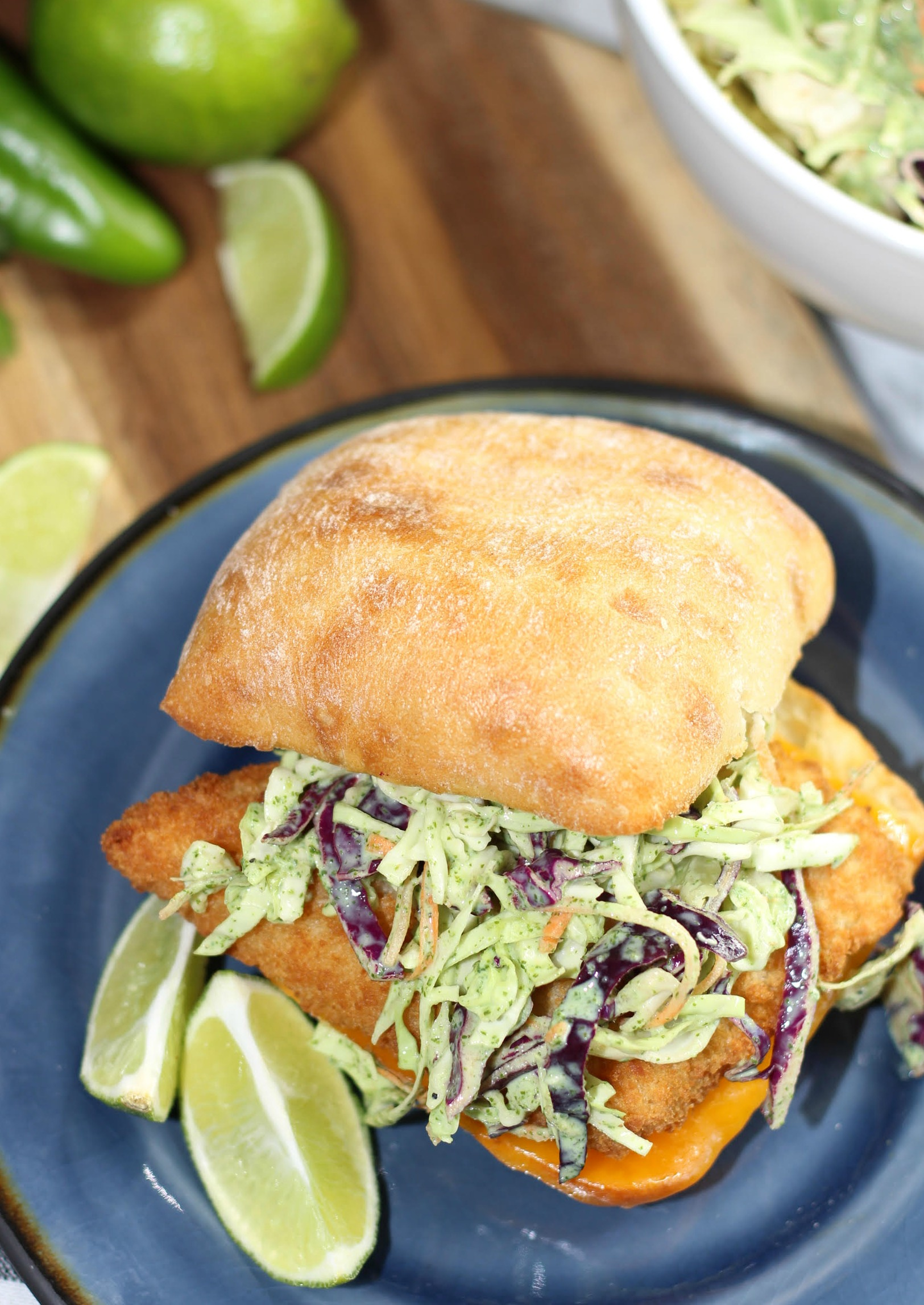 fish sandwich with Cilantro Lime Coleslaw on a plate