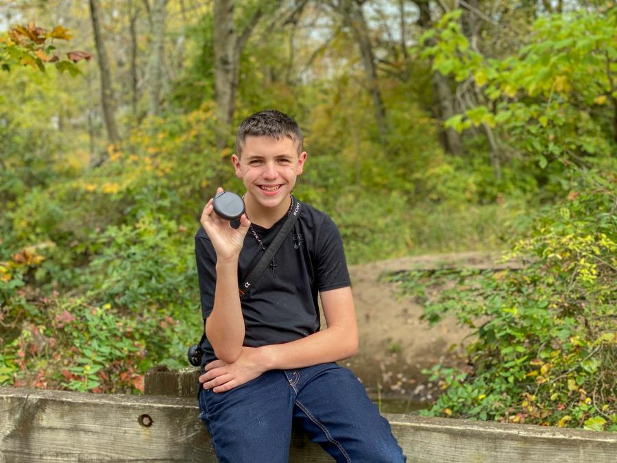 Teen holding Invisalign Case