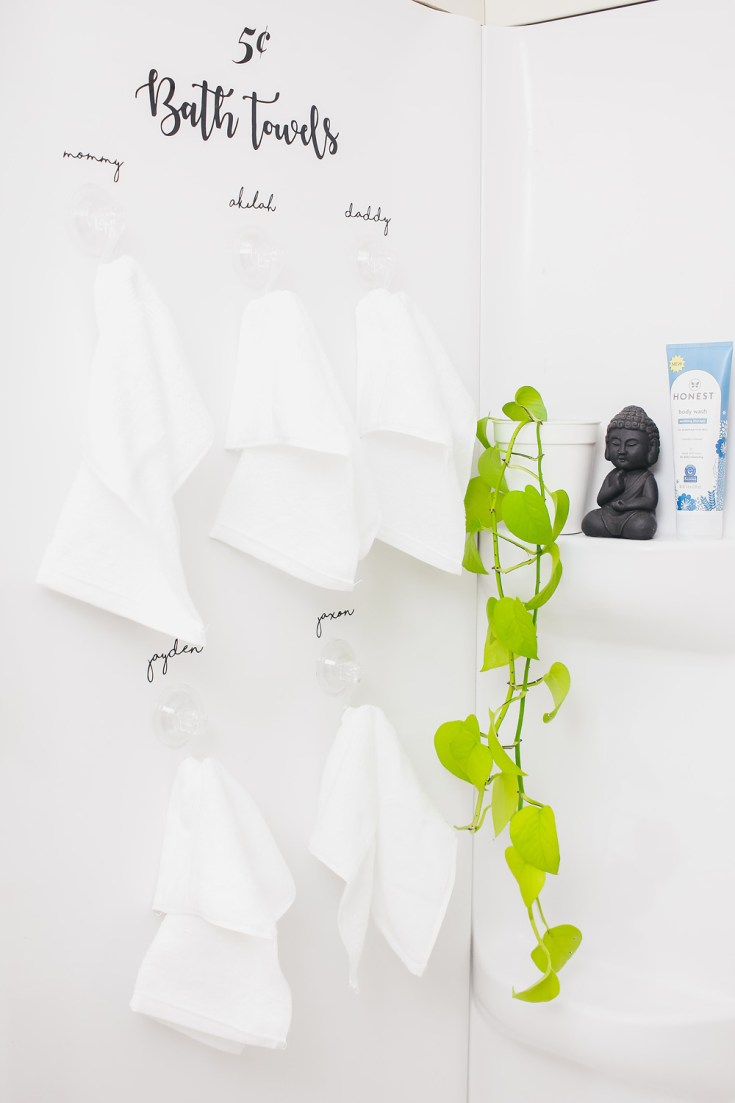 New Year Organization Idea: Bathroom Towel Display With Window Clings Created With Cricut