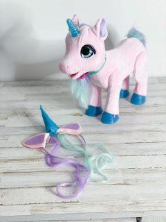 diy unicorn headband on table with toy unicorn