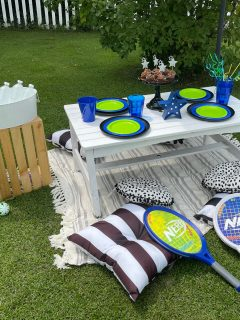 backyard table set up with blue and green decorations