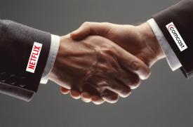 Netflix and Comcast Hand Shake