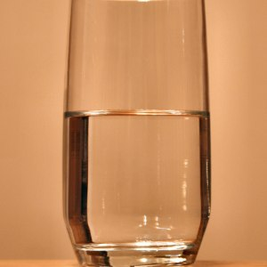 optimism-is-killing-us-glass-of-water