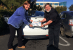 Steve Wozniak with his Tesla and Janet Wozniak