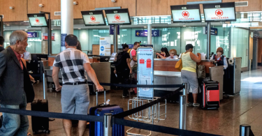 air canada line to check baggage