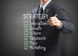 stock-photo-46508782-businessman-writing-strategy-concept