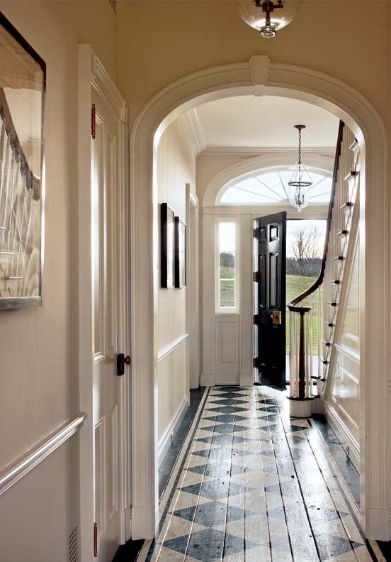 Checkerboard painted wood floors in foyer