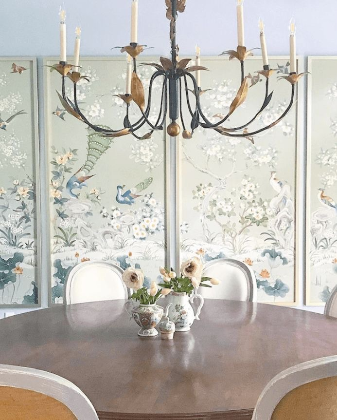Dining room with framed chinoiserie wallpaper panels