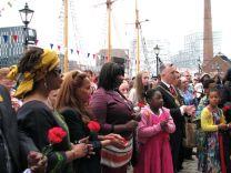 Marchers gather at dockside