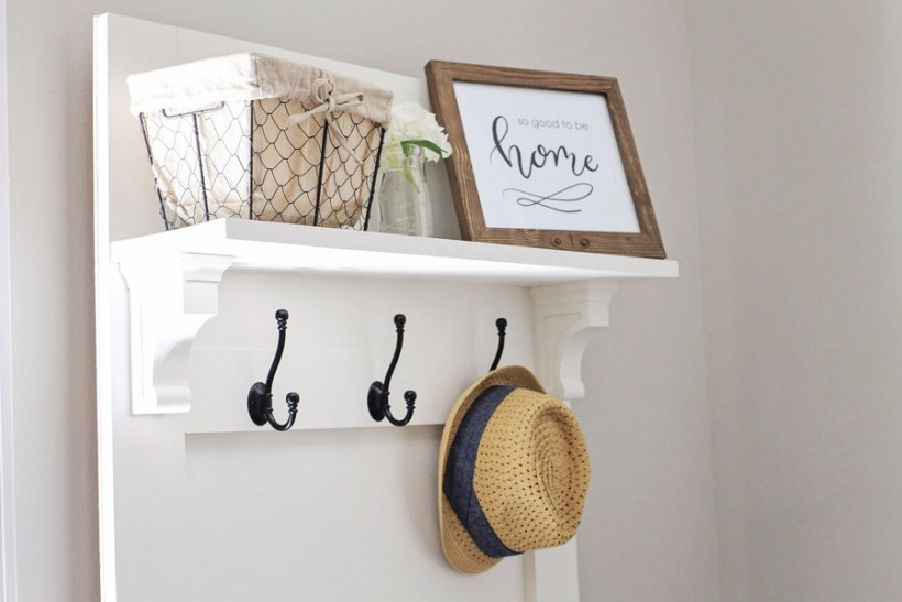 DIY hall tree shelf with picture frame, basket, and flowers