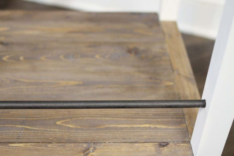 Adding the oil rubbed bronze rod to the diy industrial bar cart