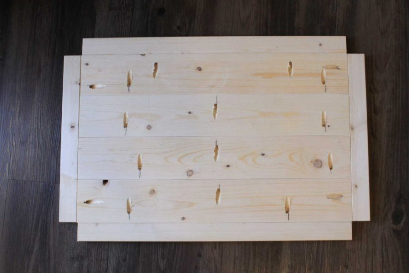 Assembling the bottom wood shelf of the bar cart
