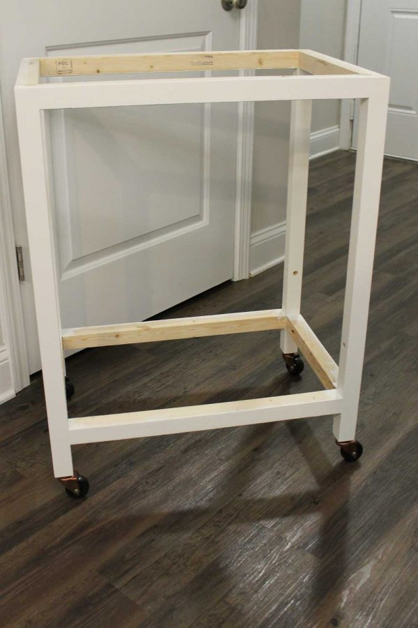 DIY bar cart with caster wheels attached