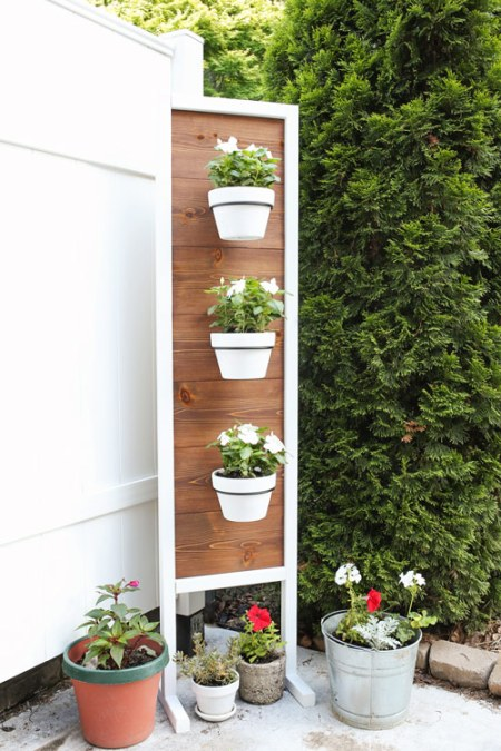 Vertical Planter DIY stand with flowers on back patio