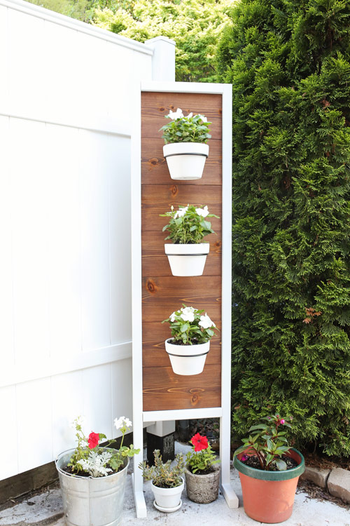 DIY Vertical Planter Stand with minwax english chestnut stain on cedar wood