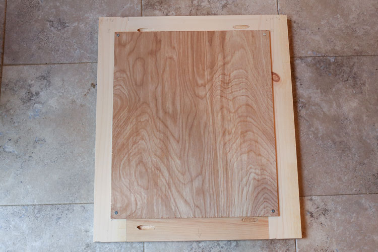 Building cabinet door for TV stand