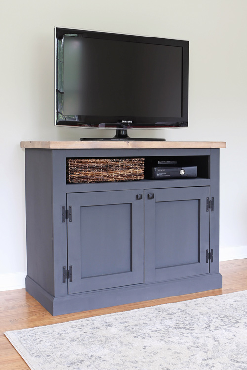 TV placed on a Gray DIY Rustic TV Stand Media Console with a weathered wood top
