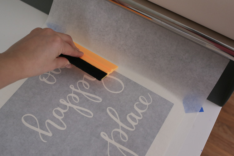 Apply transfer tape to vinyl stencil using tape roller and Squeegee