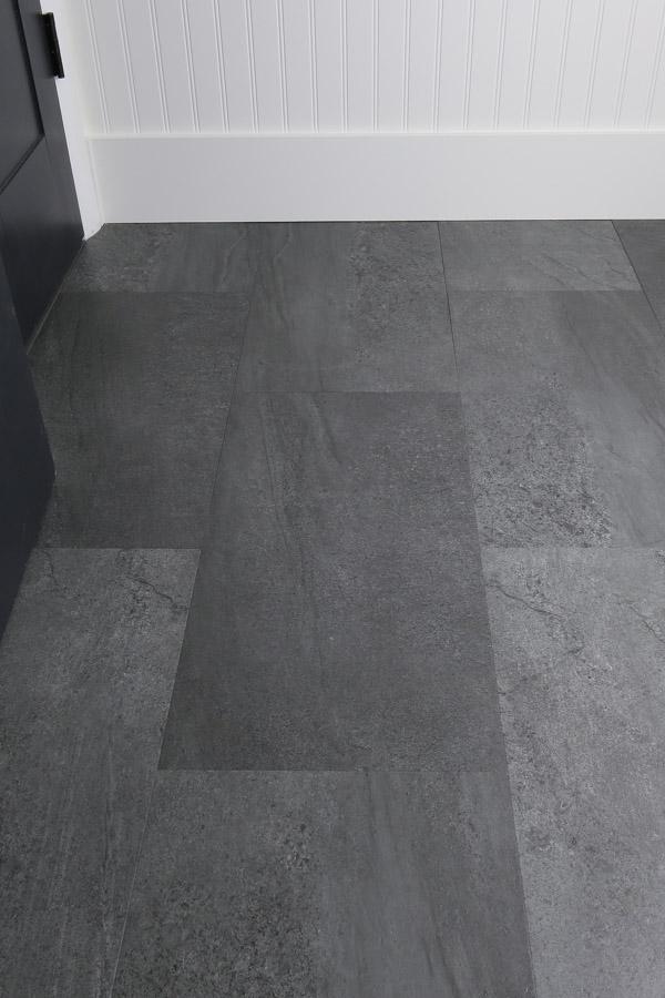 Gray slate luxury vinyl tile in DIY bathroom renovation