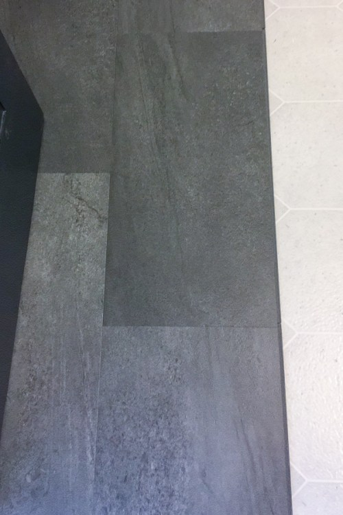 half covered bathroom floor with new luxury vinyl tile