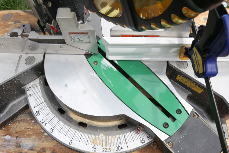Moulding is cut at a 45 degree angle with a miter saw