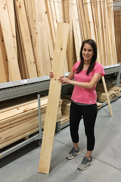 Picking out lumber in home improvement store