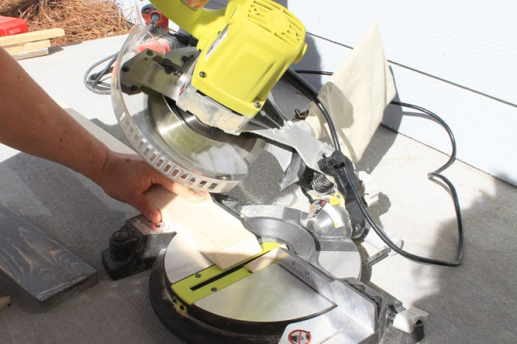 apartment building with a miter saw on apartment patio