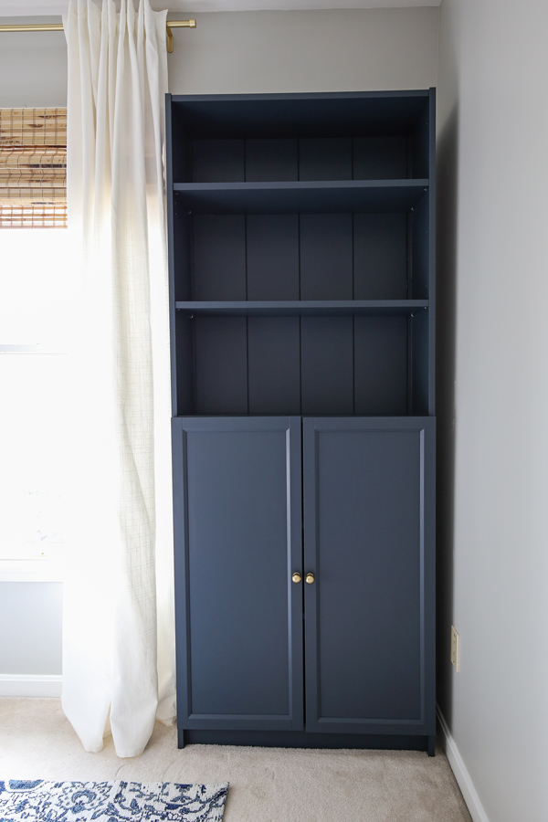 IKEA Billy bookcase hack with shiplap and painted navy blue in an office