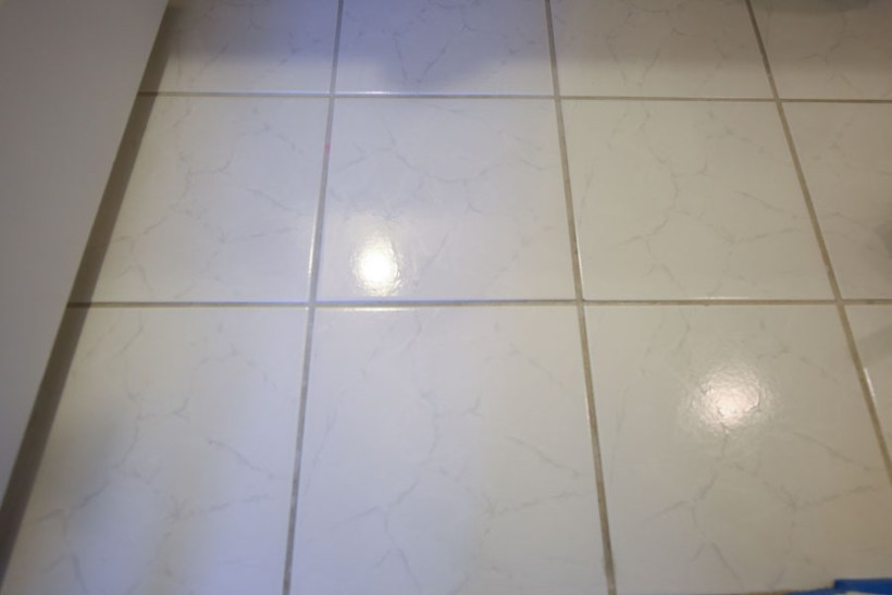 Old bathroom tile floor before painting