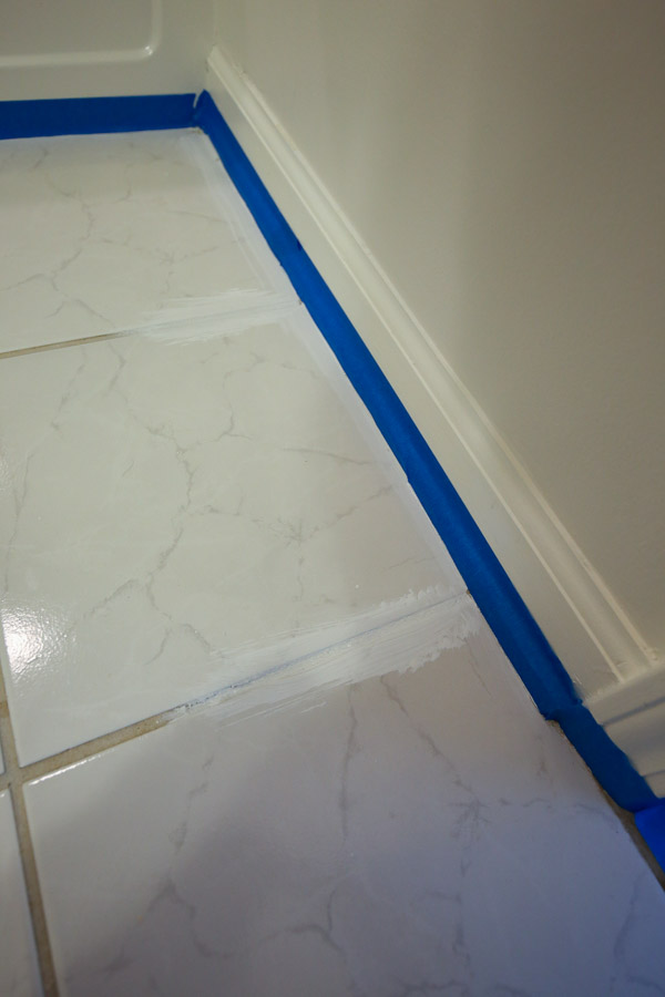 Priming edge of bathroom floor and tile grout lines