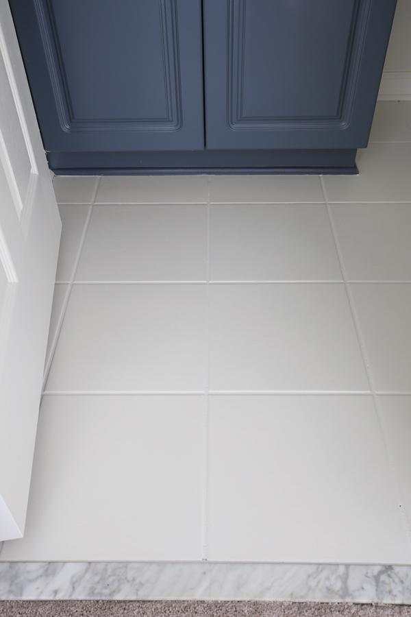 white painted floor tiles in bathroom