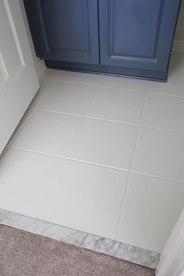 ceramic floor tile painted white in a bathroom