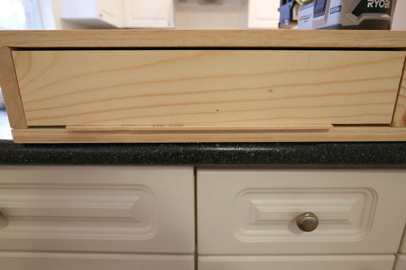 Attaching the drawer faces to the makeup vanity