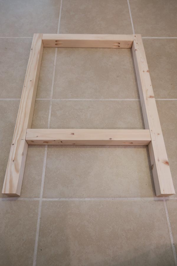 Attaching left side of makeup vanity legs together