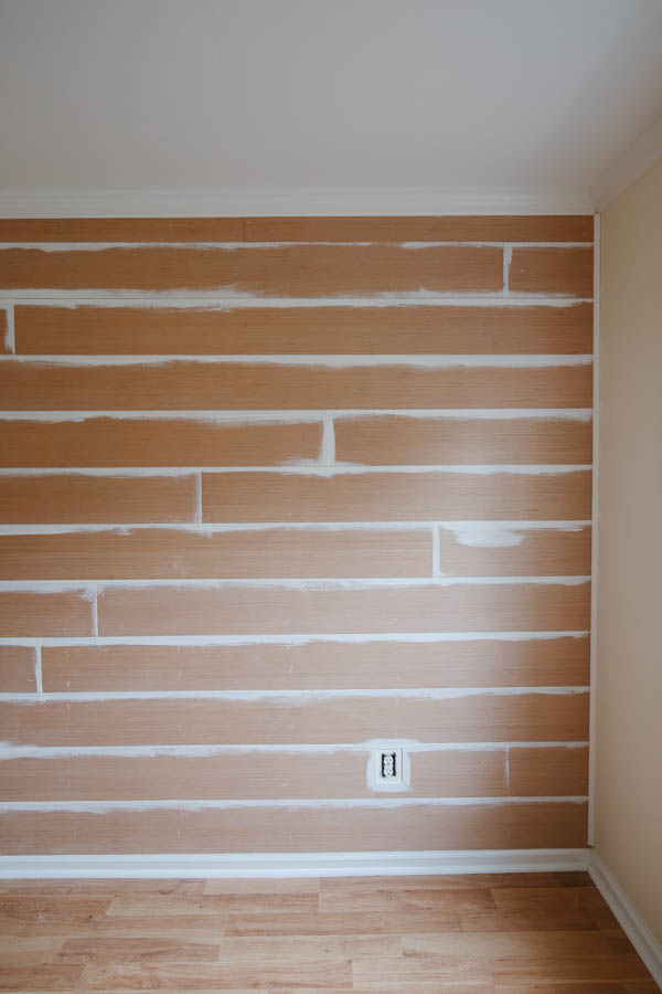 partially painted shiplap wall after shiplap installation
