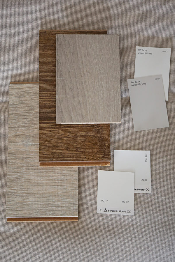 Comparing flooring, fabric, decor, and paint color swatches