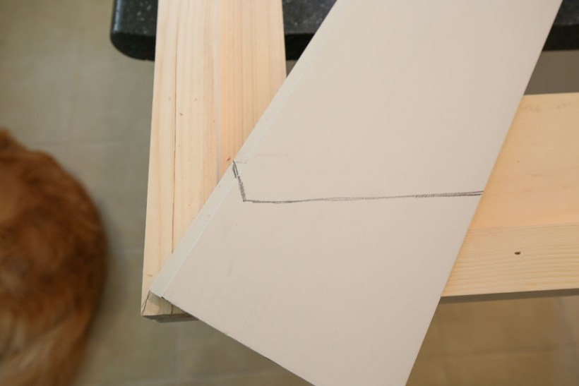 marking where to cut shiplap board for DIY barn door