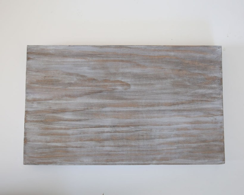 apply a weathered wood finish to flag sign backing