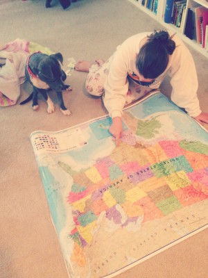 Our dog, Lucy, getting a geography lesson.